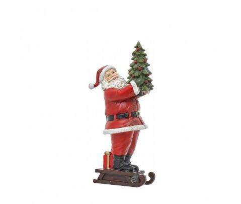 Papa Noel de pie sobre trineo